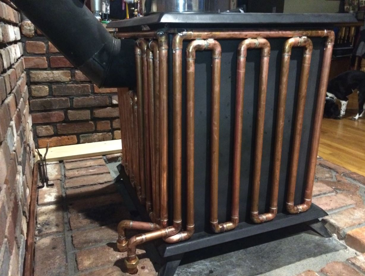 copper-piping-around-a-wood-burner-heating-water-to-radiators